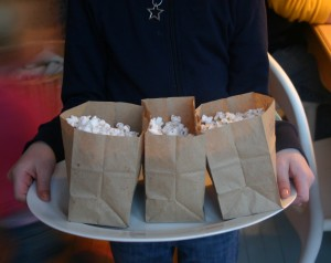 Popcorn served in brown paper lunch bags.