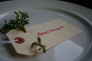 Thyme is threaded through the holes of a place card to appeal to eye and nose.
