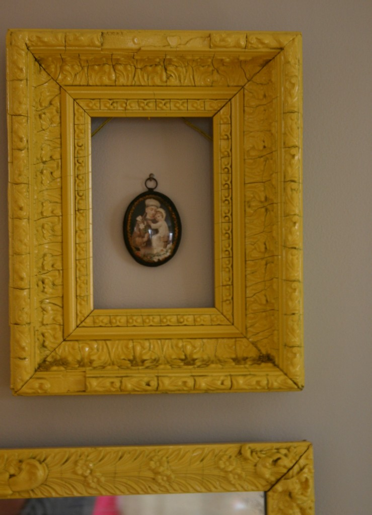 You can leave the space within the frames empty or tack unusual items on the wall. I am a fan of decorating that I can change whenever the moment strikes me - I can tack up whatever strikes me.