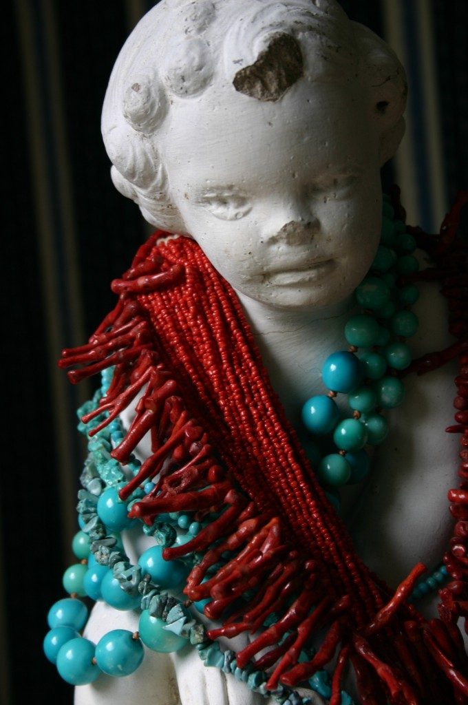 My favorite necklaces draped around the neck of an old statue.