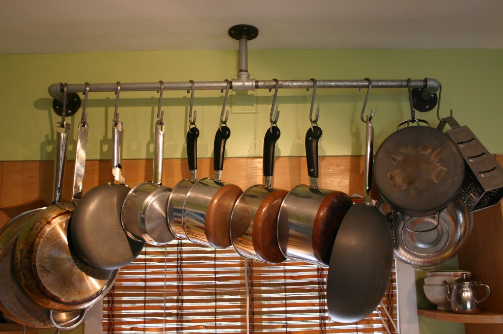 After months of searching for pot racks and never finding anything I really liked or could affford - I came up with this solution. Created from pipe parts purchased at Home Depot I designed this pot rack; it has that industrial look that I am drawn to.