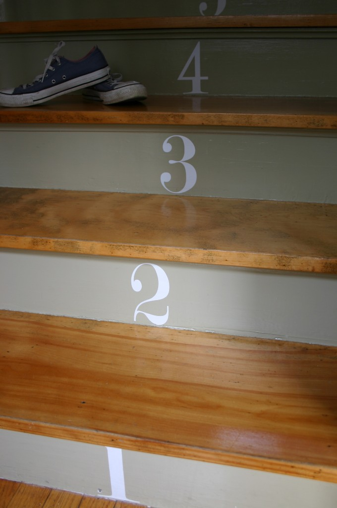 Our stairs are the first thing people see when they walk in our front door - so I decided to make them a focal point. Painting the risers a slightly different color from the walls and applying vinyl decals that I designed onine - we created a look that gets attention straight away. Children love to count out the stairs as they walk up - so it doubles as an educational tool!