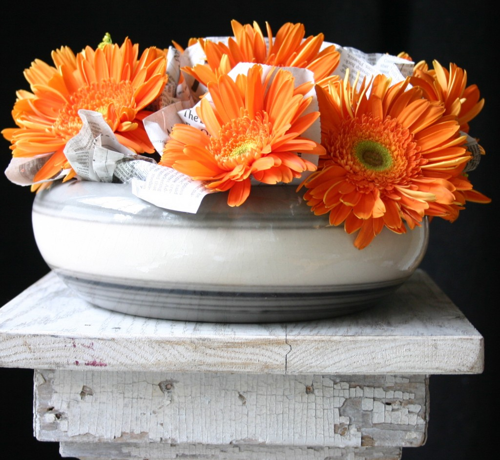 Contrasts interest me - I enjoy the surprise of unlikely duos. I used newspaper and wrapped it around the stems of these gerbera daisies and tucked it in between the stems.