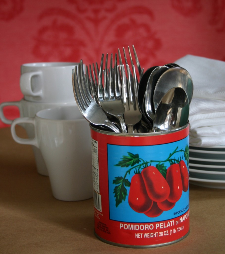 Canned tomatoes, imported from Italy, come in gorgeous cans. Love the graphics and the colors are bright and striking - I used them to hold utnensils at a buffet.