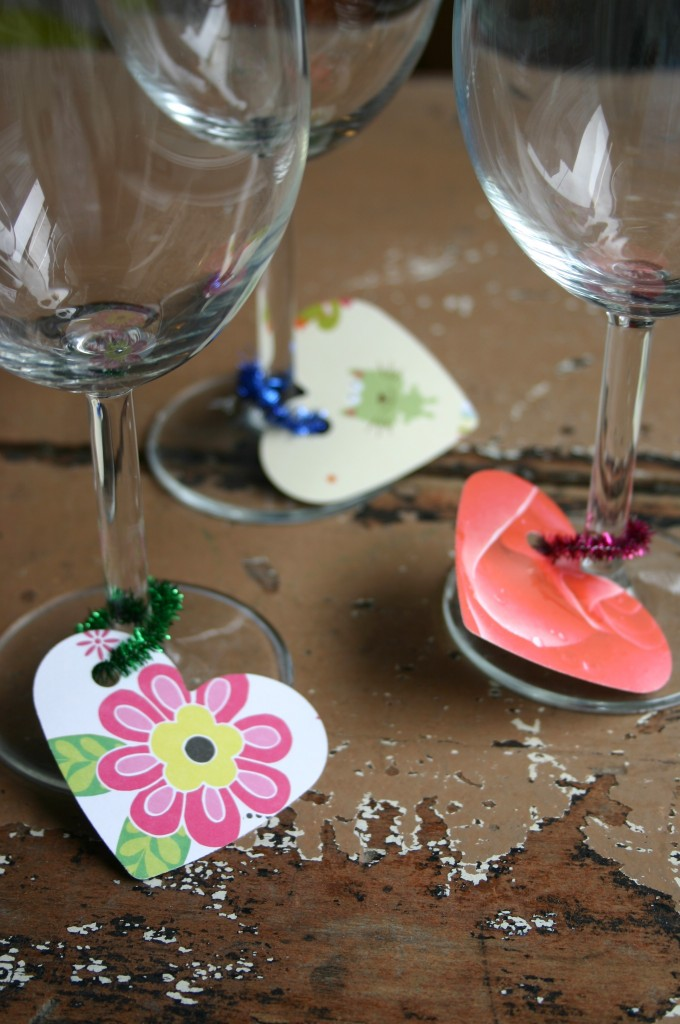 I try to reuse birthday and greeting cards as often as possible - here I used a die cut to punch out heart shapes from a group of old cards. I attached these to the wine glass stems with glitter stick metalic pipe cleaners. Slimply cut pipe cleaners into about 2 inch pieces, slip card on and twist to close.