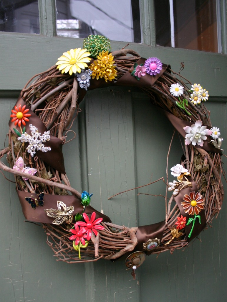 To make this wreath - wrap ribbon around a grapevine wreath and attach pins - it is as easy as that.