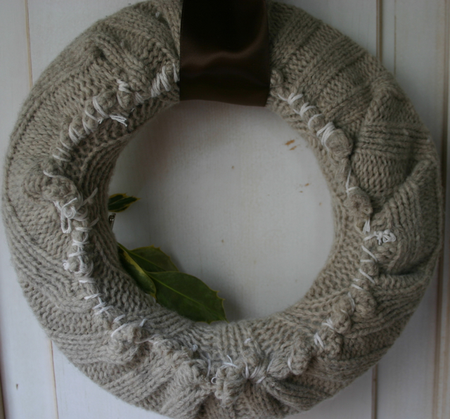 I wrapped the sweater around the wreath frame and stitched it closed using a large sewing needle.