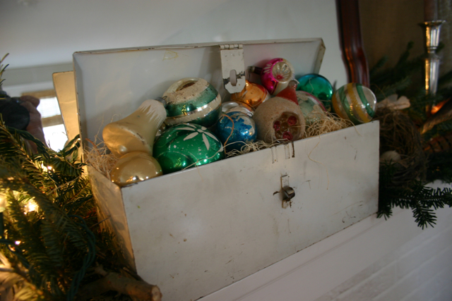 My old tool box is filled with wood shavings and vintage Christmas ornaments.