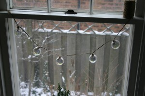 Try hanging the strand in a window. The glass balls look great backlit with natural light.