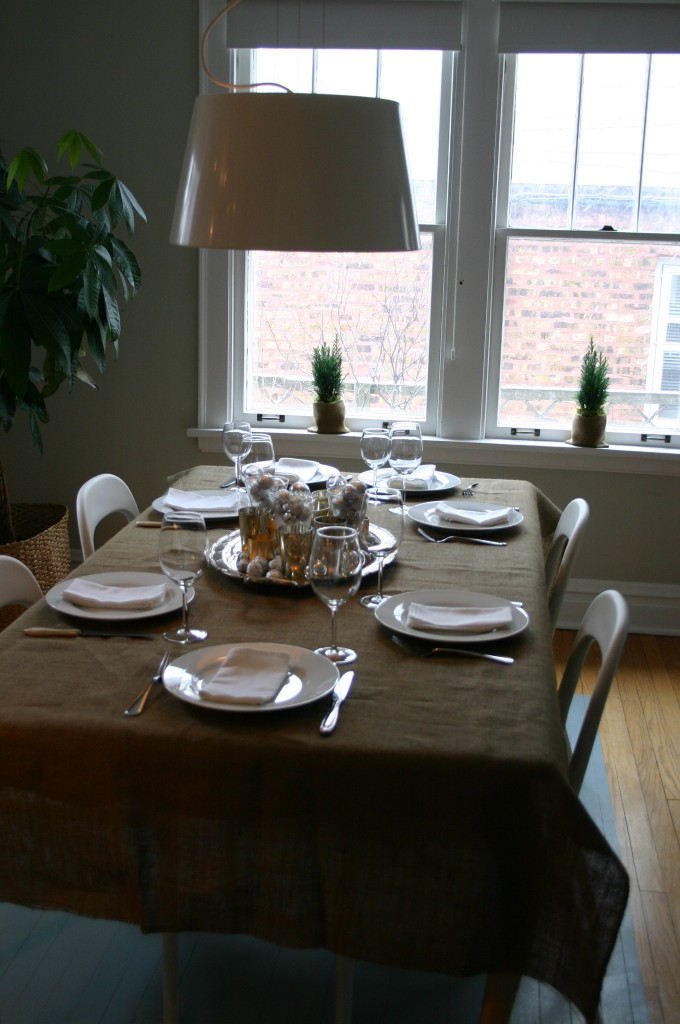 Simple and calm, the table is ready for an enjoyable meal with family.