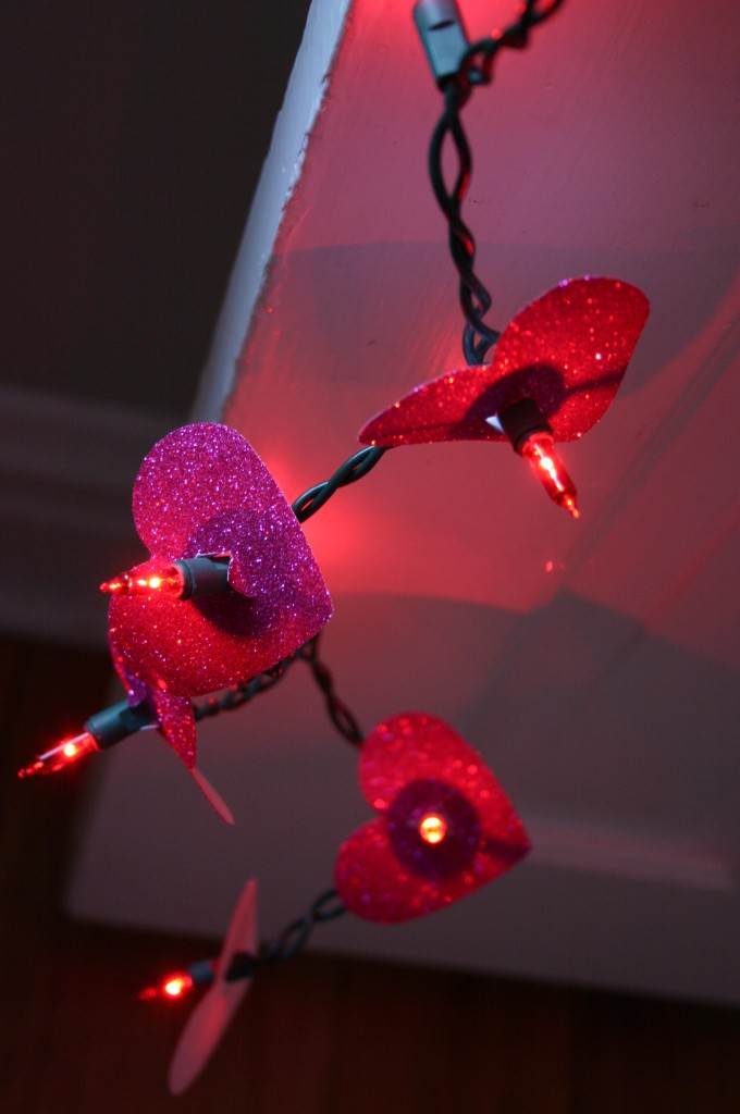 A short strand of 35 red lights are decorated with red glittery paper hearts.