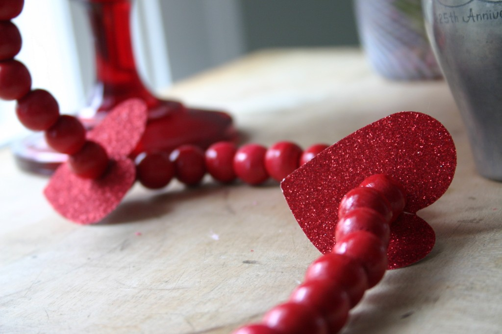 Making this type of cut, allows the hearts to slip on easily in between the beads.