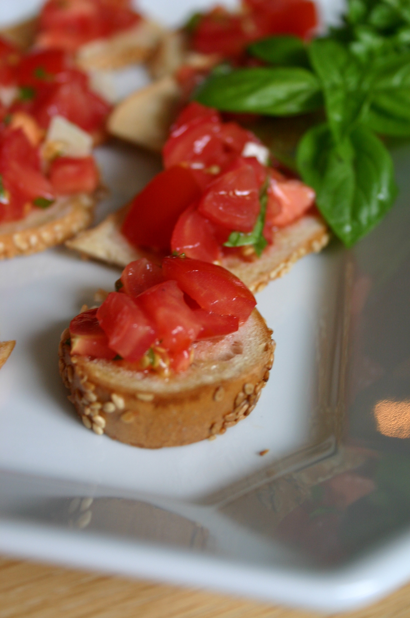 What to do with 2 left over bagels from Sunday morning breakfast? Try making this simple bagel bruschetta - you'll be surprised to see how many pieces you can get from 2 bagels.