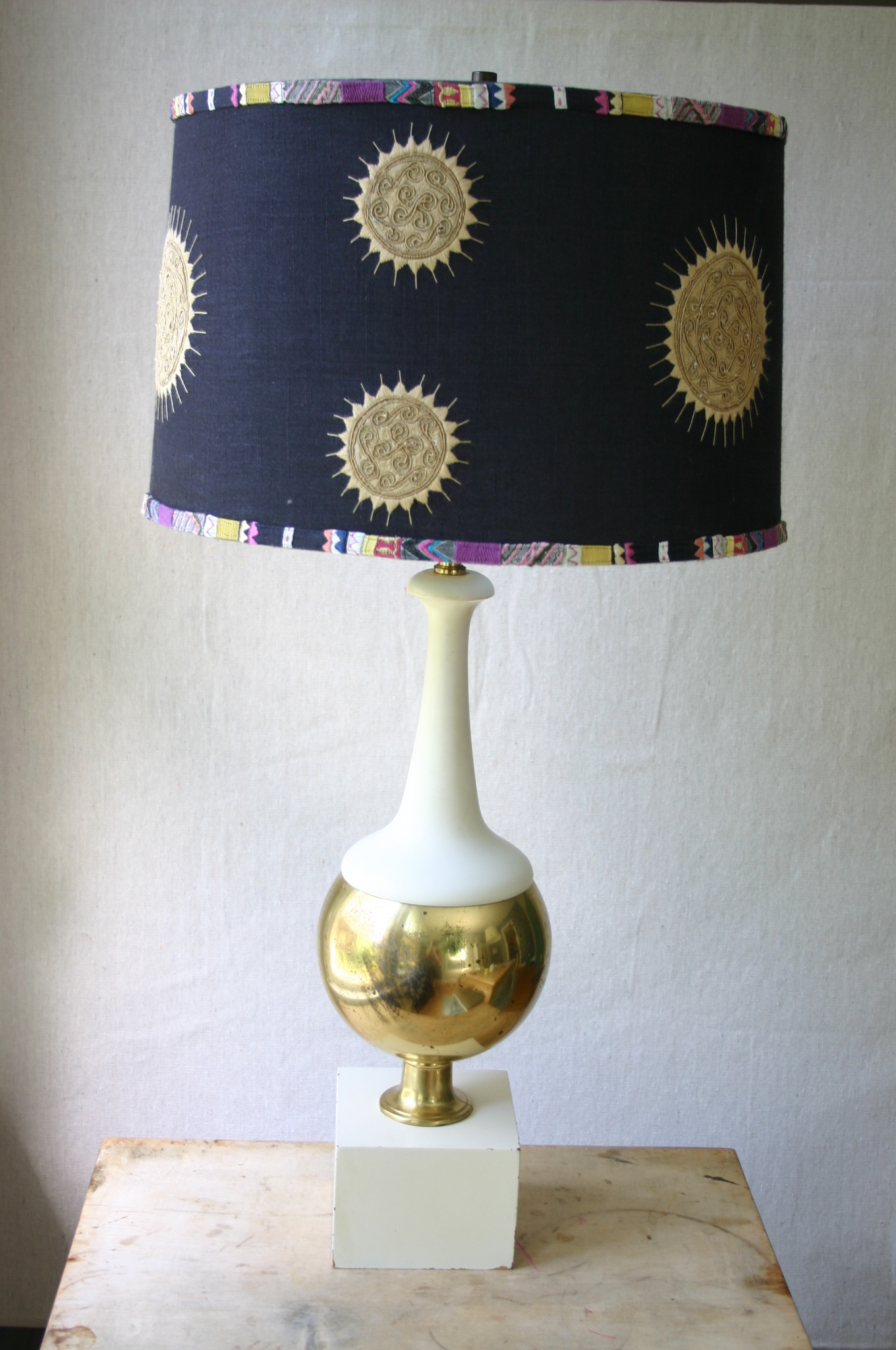 I picked up this lamp base for $7.00 at a local thrift store. Because I spent so little on it, I didn't mind splurging on the shade. Luckily, I found this great looking shade at Anthropolgie - on sale for $70.00. I love the combination of clean smooth lines with ethnic prints.