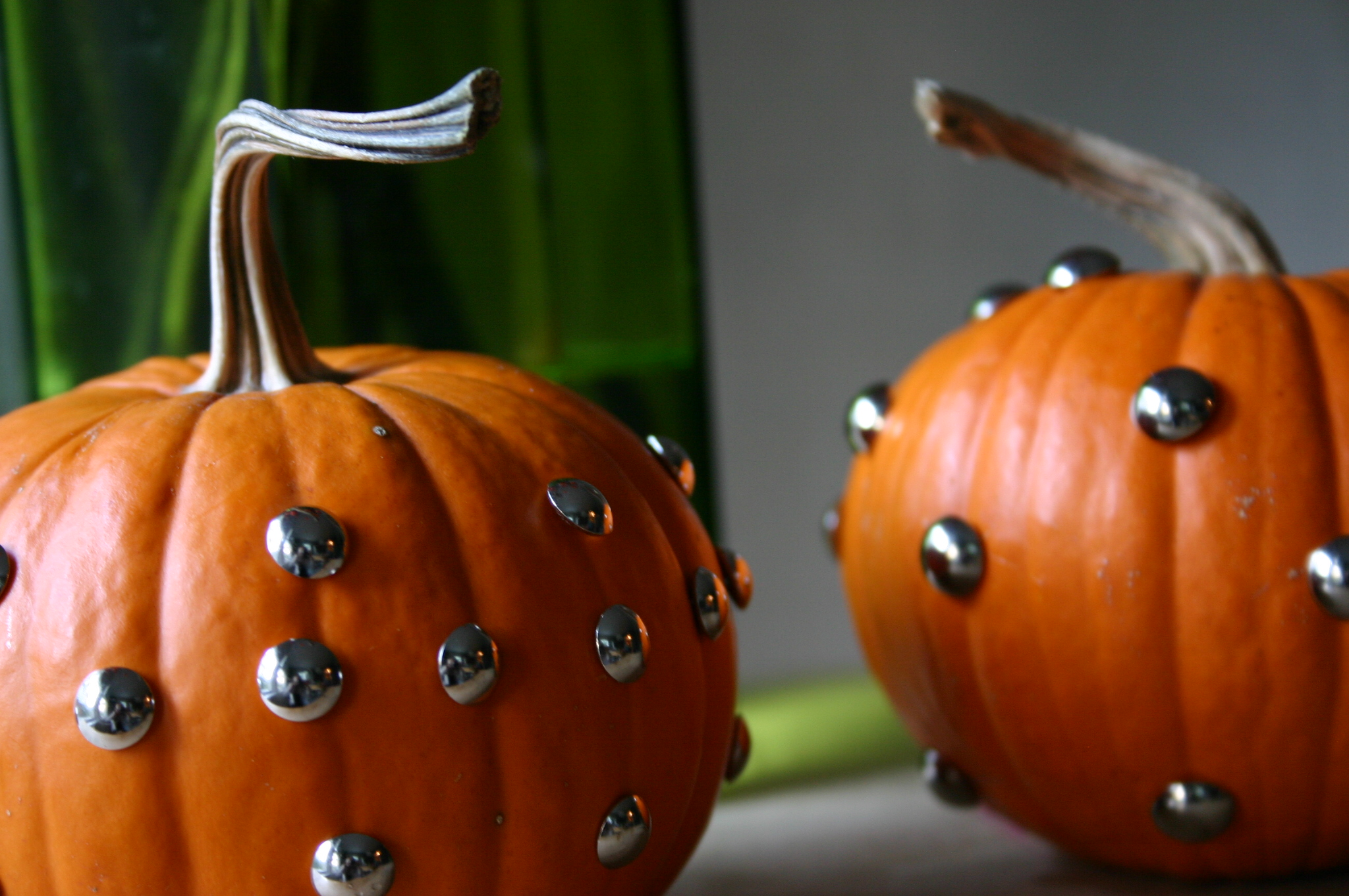 It doesn't get easier than this - just push the tacks into the pumpkin.