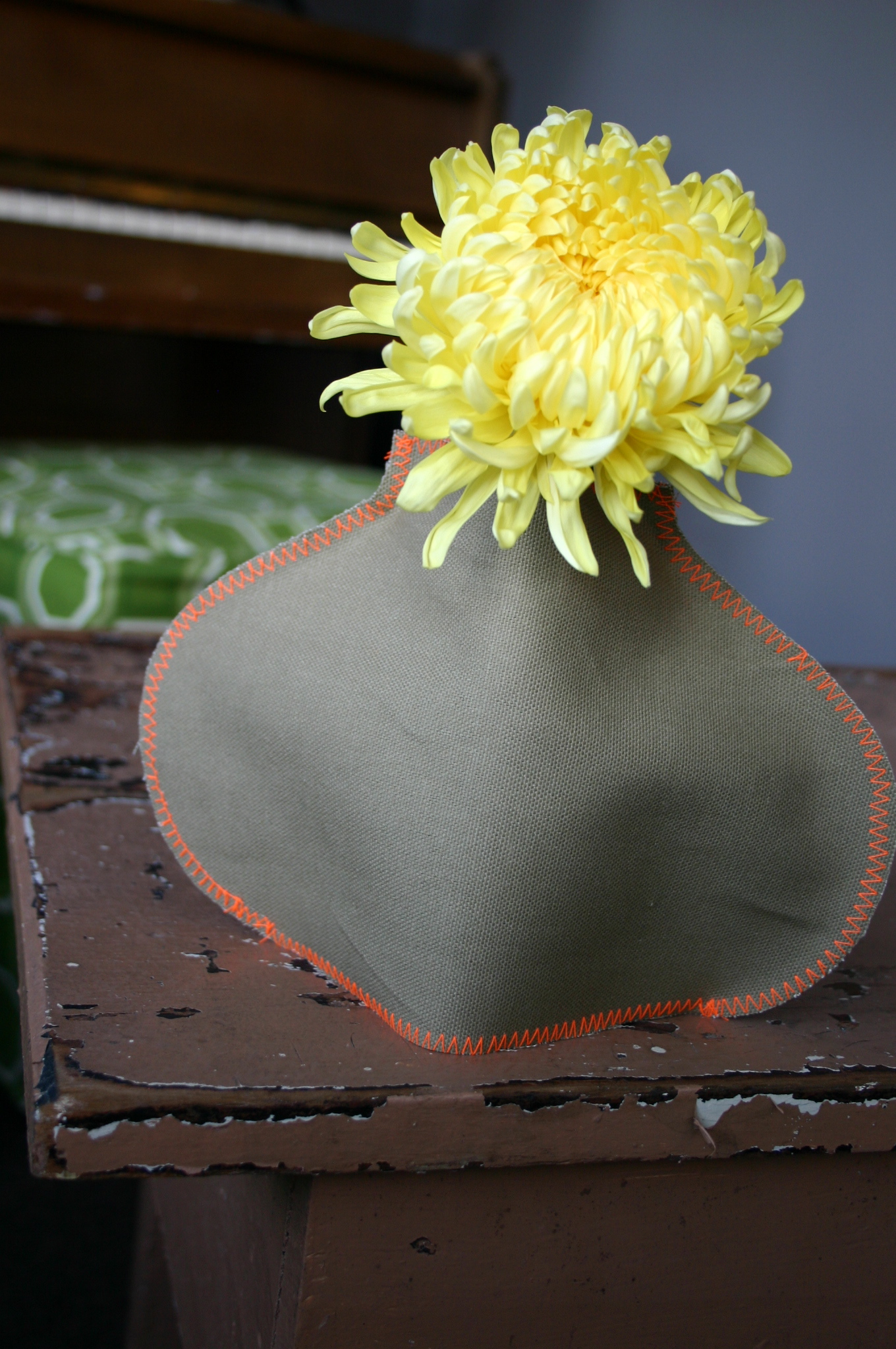 A canvas cover in the shap of a vase gives a jelly jar a quick makeover.
