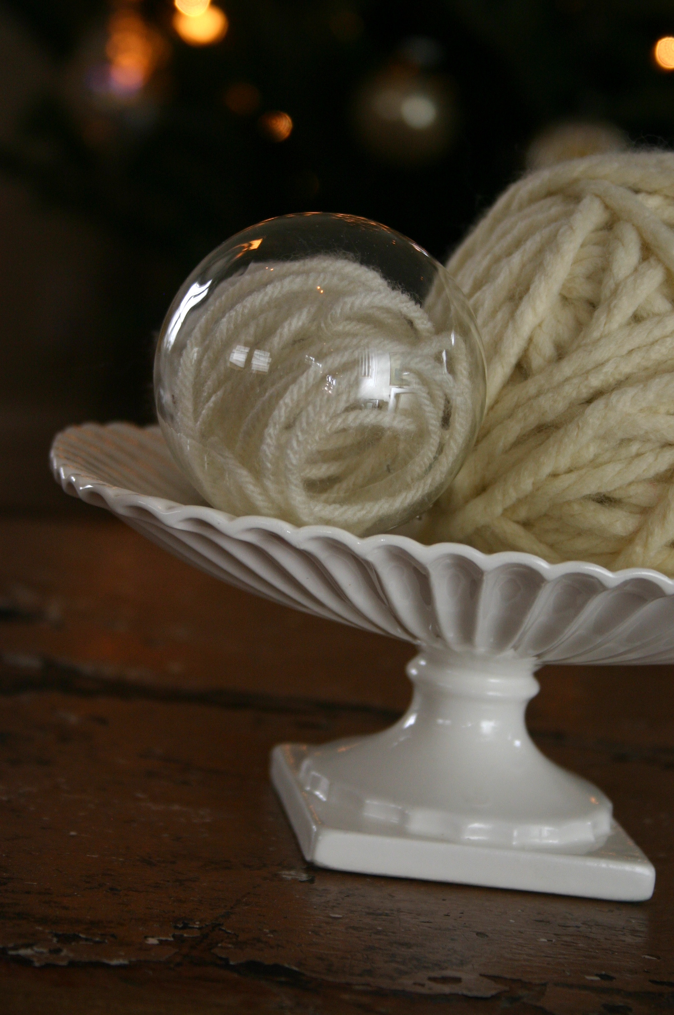 Plain glass balls are filled with  yarn to create an interesting ornament.