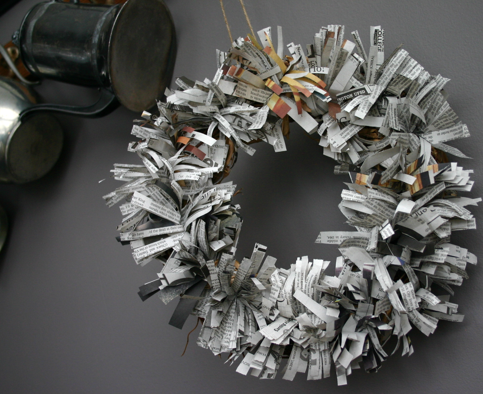 Small shredded fans of newspaper are tucked into a grapevine wreath to create a holiday look that really says something.