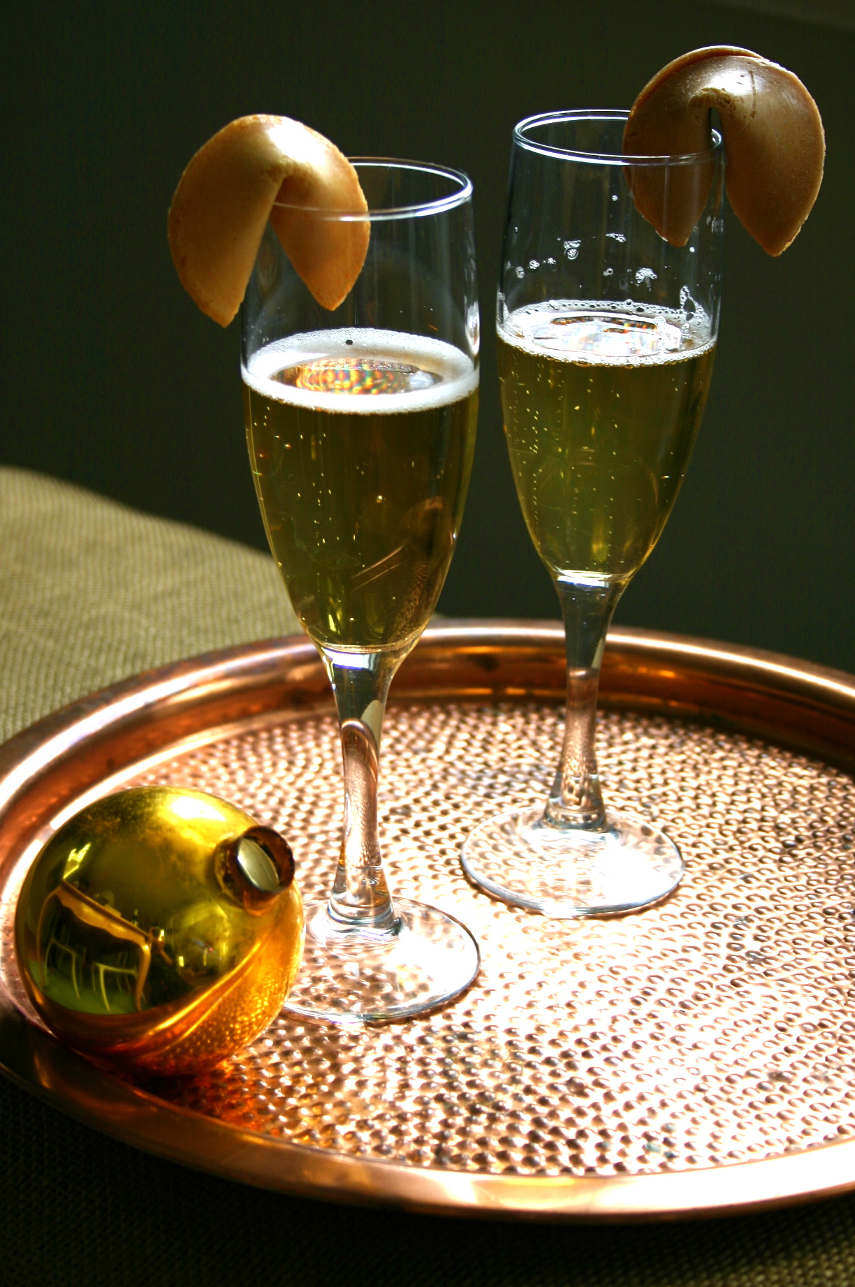 Something different at midnight - try perching a fortune cookie on the rim of your champagne flute this New Year's Eve. I did this with sparkling apple cider and my kids loved it.
