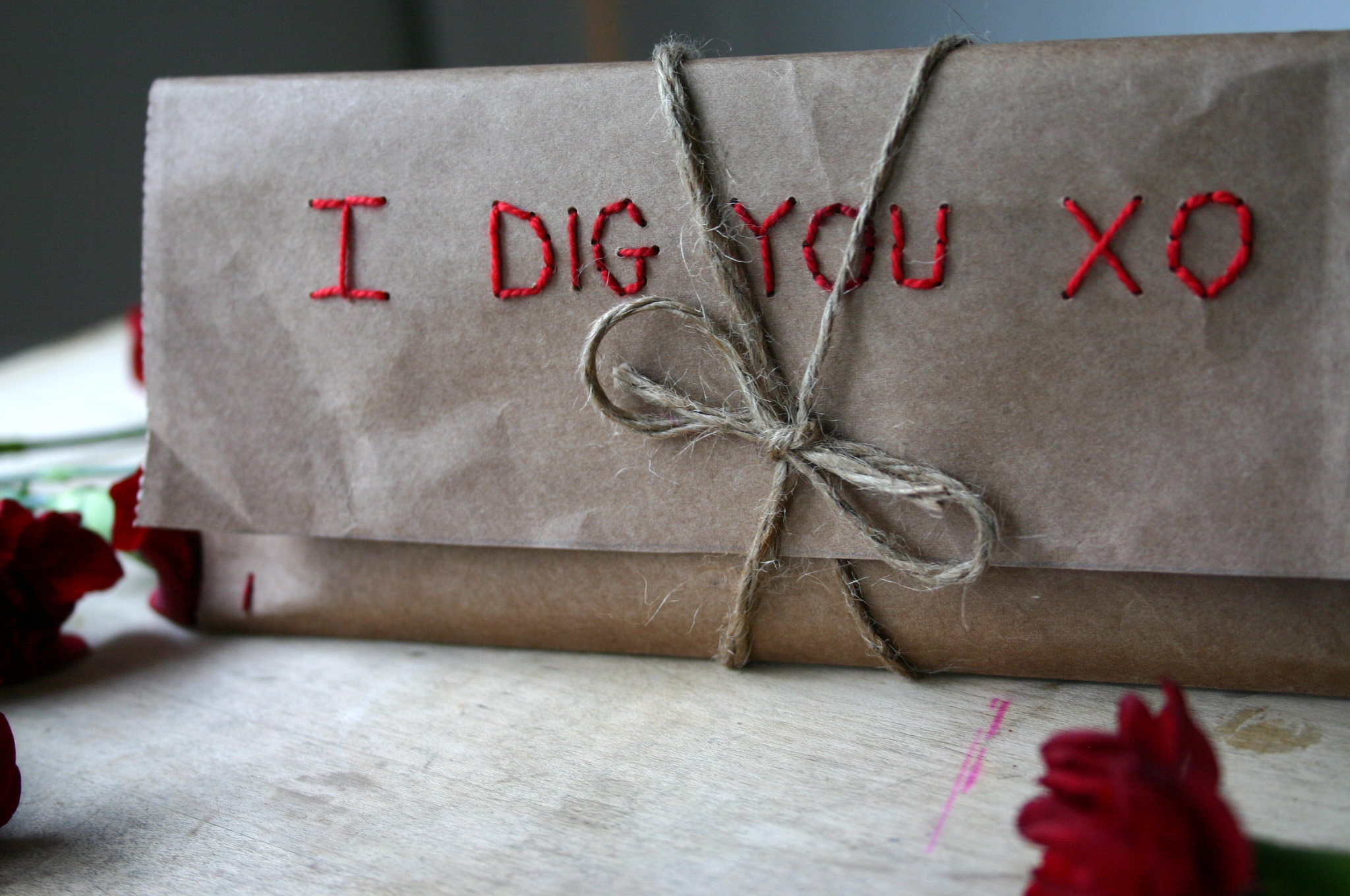 A chocolate bar is wrapped in an embroidered paper bag envelope to make a sweet and thoughtful Valentine.
