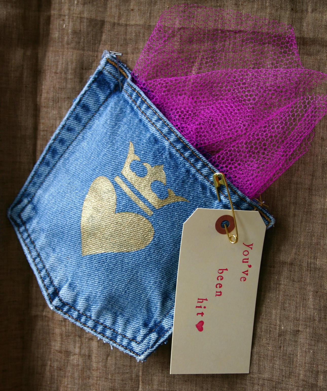 The back pocket from a pair of jeans is used to make Valentine's Day goody bag.