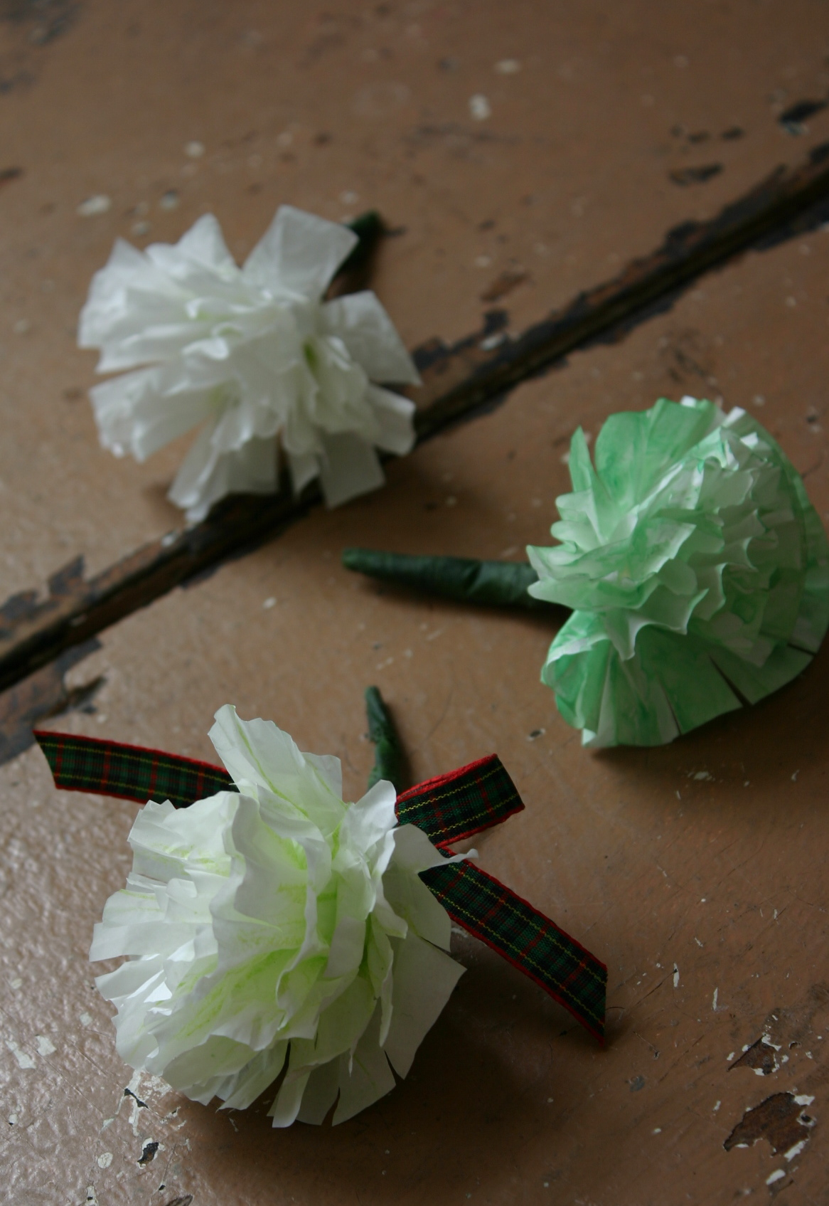 Boutenieres made from cupcake liners are easy to make and kids love them!
