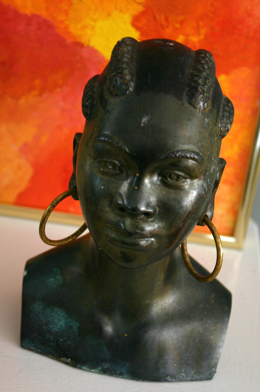 Sitting further back on a crowded shelf, I almost missed this beautiful bronze bust of an African woman. Also priced at $30.00 - I knew it had to be mine. A signature on the back allowed me to do a quick Google search to discover that it is an Eames era lamp base .