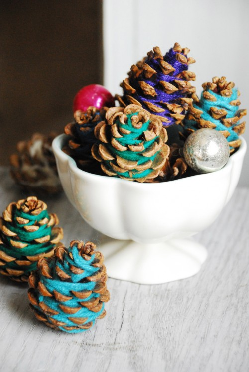 Grab your leftover yarn and a bag of pine cones and start wrapping. These make great gift toppers too.