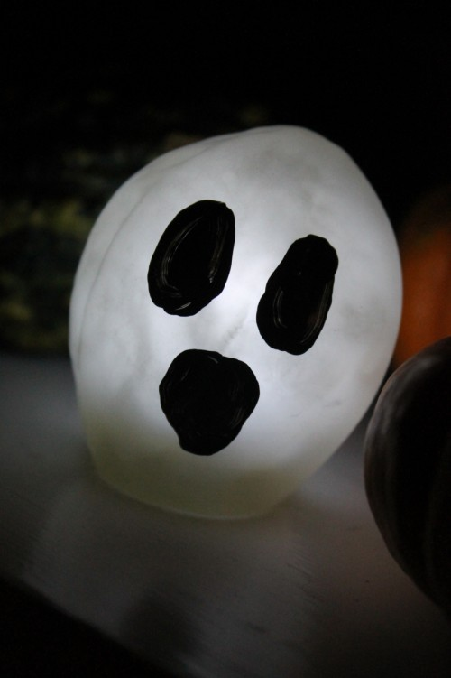 Small ghost heads light the way on Halloween. These are made from clear balloons, bright white LED lights, stuffing and black craft paint.