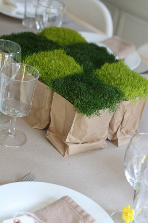 Potted scotch moss ($3.98 each, Home Depot) are placed in cutoff paper lunchbags and arranged in a checkerboard pattern on the table.