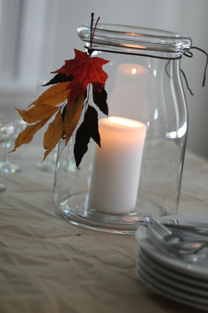 Dress up a candle jar with a tassel made from dried fall leaves.